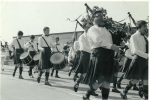 A procession in the sixties, with Bill Hennessy, John Mahon(?) and Mike Higgins on the side drum, Tony Sherratt on the tenor drum, and Terry Dowling, Peter Cummins and Bill Lisgo on the pipes.
