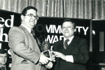Terry receiving the Irish Post and Allied Irish Banks award on the band's behalf for furthering Anglo-Irish relations.